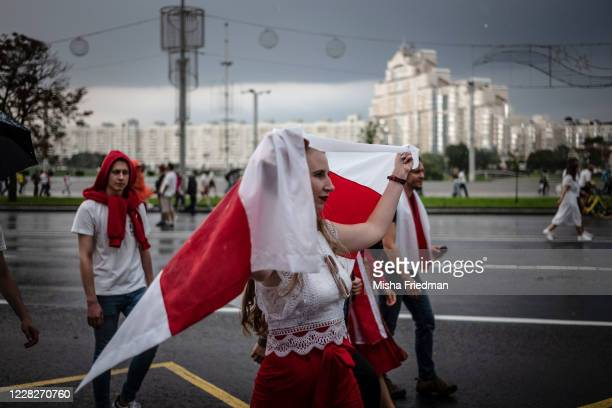 People take part in an anti-governmental rally in the rain on August 30, 2020 in Minsk, Belarus. There have been near daily demonstrations after the...