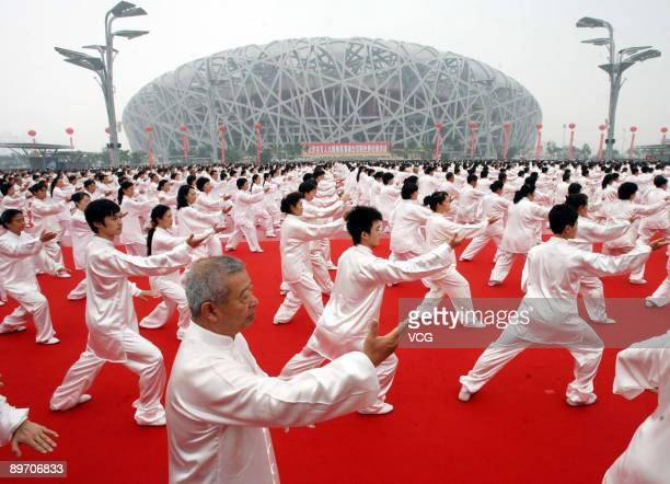 33996 people take part in an attempt to break the Guinness world record for the largest number of people practising Tai Chi outside the National...