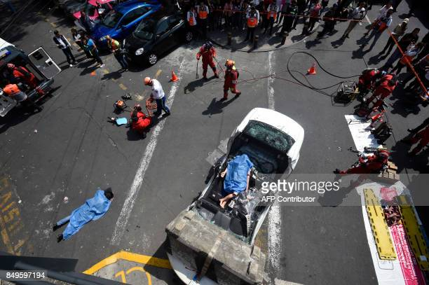 People take part in an earthquake drill in Mexico City on September 19 2017 as the country commemorates a new anniversary of the 81 quake that in...