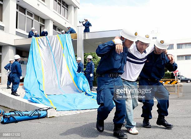 People take part in an emergency drill on September 1 2016 in Yatomi Aichi Japan emergency drills are held across the nation on September 1 the...