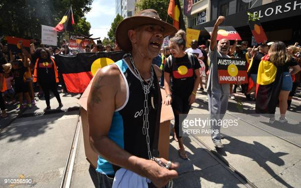 People take part in an 'Invasion Day' rally on Australia Day in Melbourne on January 26 2018 Thousands of supporters joined rallies across Australia...