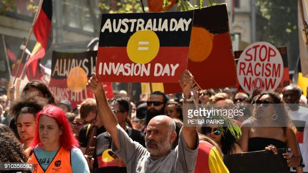People take part in an Invasion Day rally on Australia Day in Melbourne on January 26 2018 Thousands of supporters joined rallies across Australia...