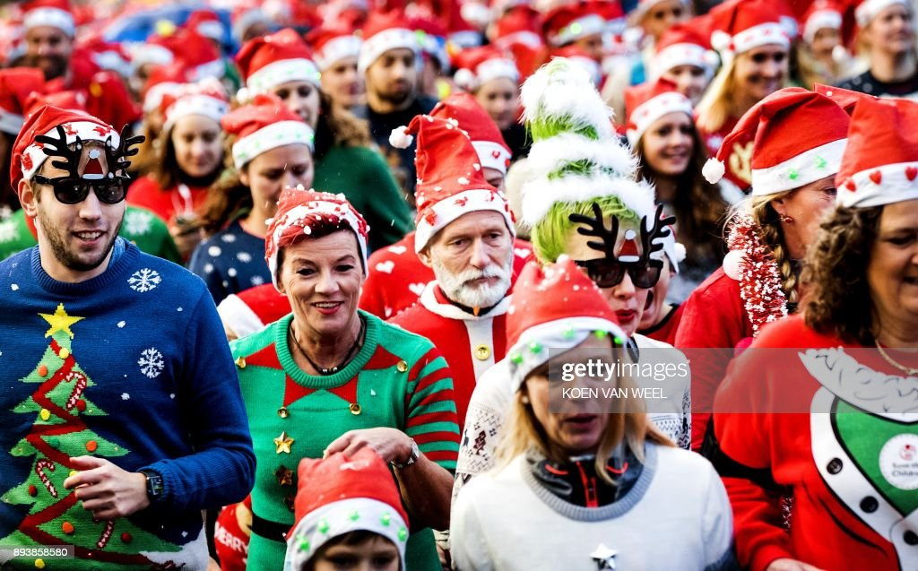 People take part in an Ugly Christmas Sweater Run on December 16 ...
