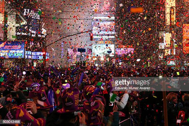 People take part in celebrations at Times Square on January 1 2016 in New York City At least 6000 police officers were deployed including rooftop...