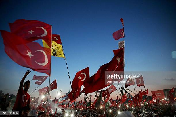 People take part in Democracy and Martyrs' Rally held to protest against the July 15 failed coup by the Fetullah Terrorist Organization at Yenikapi...