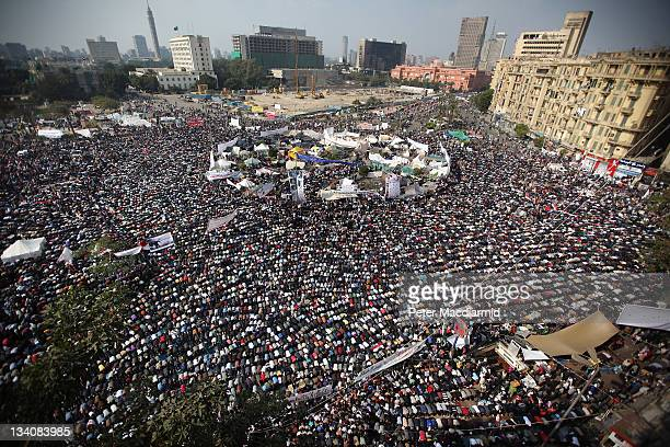 People take part in Friday prayers in Tahrir Square before a mass rally on November 25, 2011 in Cairo, Egypt. Thousands of Egyptians are continuing...
