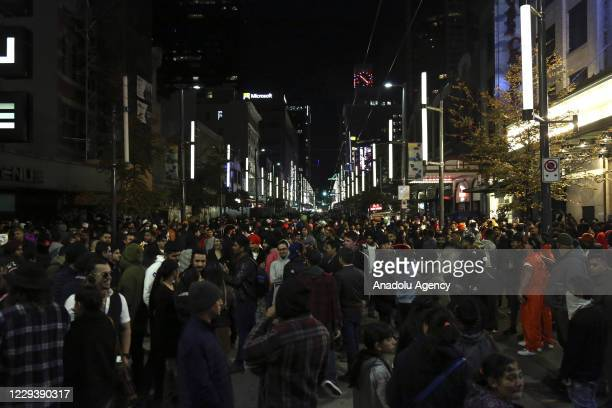 People take part in Halloween celebration on Granville Street in Vancouver, British Columbia, Canada on October 31, 2020.