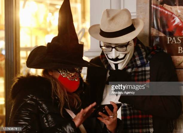 People take part in Halloween celebrations in London, United Kingdom on November 01, 2020. People dress and use make-up to make themselves look like...