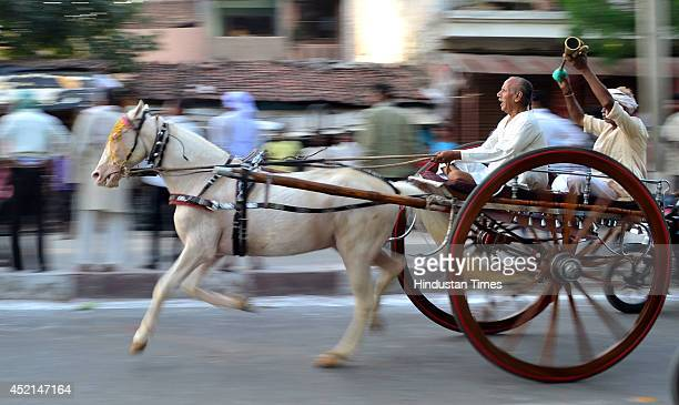 People take part in horse cart racing Gehre Bazi on the streets of Sangam City on July 14 2014 in Allahabad India The traditional sport is organized...
