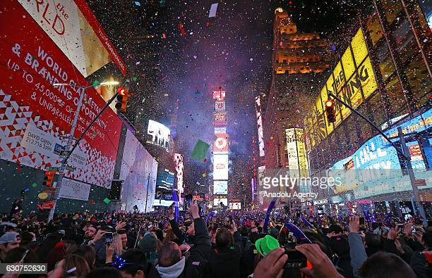 People take part in New Year celebrations at New York's Times Square NY USA on January 01 2017 An estimated one million people assembled on New...