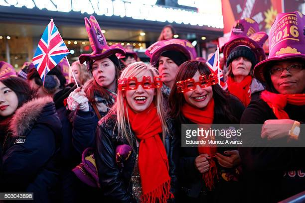 People take part in New Year's Eve celebrations at Times Square on December 31 2015 in New York City At least 6000 police officers have been deployed...
