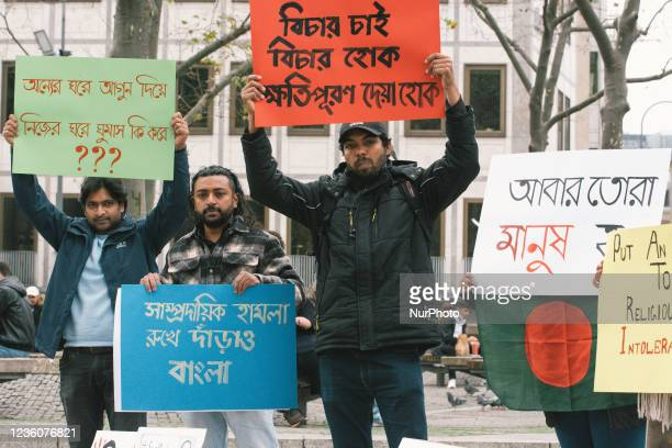 People take part in protest in front of Dom Cathedral in Cologne, Germany on Oct 23 against violence attack against Hindus in Bangladesch during...