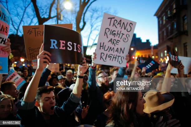 People take part in rally outside the Stonewall Inn a landmark of the gay rights movement on February 23 2017 in the Greenwich Village area of New...