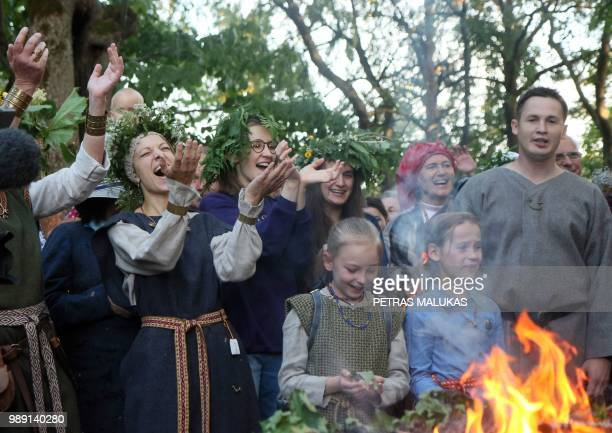 People take part in rire rituals to the Lizdeika altar during the traditional Lithuanian summer solstice in Verkiai Park in Vilnius on June 22 2018...