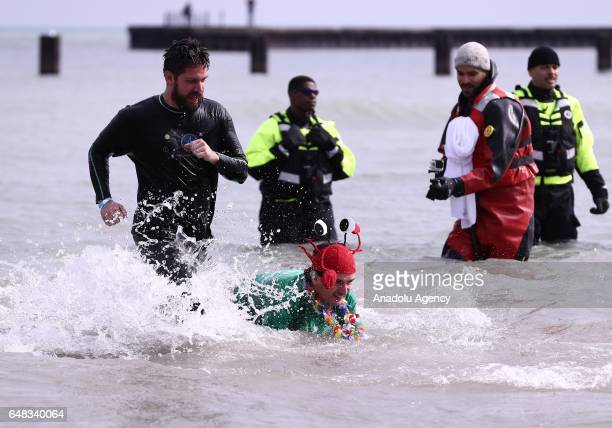 People take part in the 17th Annual Chicago Polar Plunge organized to support the athletes of Special Olympics at North Ave Beach of Michigan Lake in...