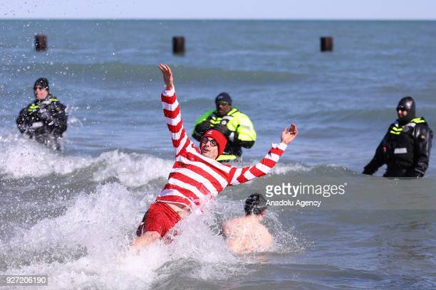 People take part in the 18th Annual Chicago Polar Plunge organized to support the athletes of Special Olympics at North Ave Beach of Michigan Lake in...