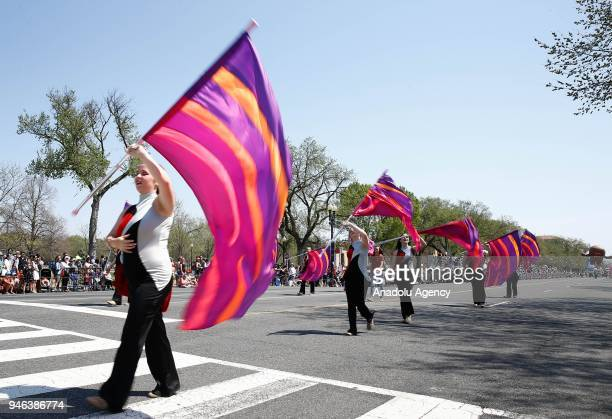 People take part in the '2018 National Cherry Blossom Festival Parade' in Washington United States on April 14 2018