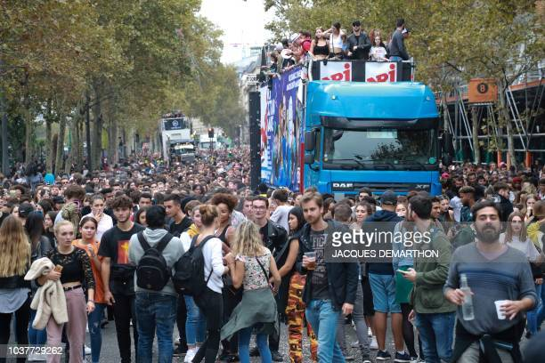 People take part in the 20th annual Techno Parade in Paris on September 22 2018