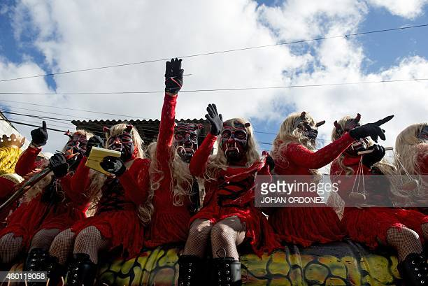 People take part in the '24 devils dance' during the Virgin of the Immaculate Conception celebrations on December 7 2014 in Sacatepequez some 60 km...