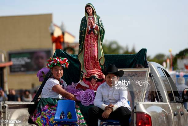 People take part in the 87th Annual Procession and Mass in honor of Our Lady of Guadalupe in Los Angeles California on December 9 2018 The Catholic...