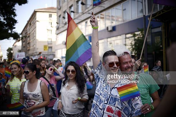 People take part in the annual Gay Pride parade in central Sofia on July 5 as people march through the Bulgarian capital to protest discrimination...