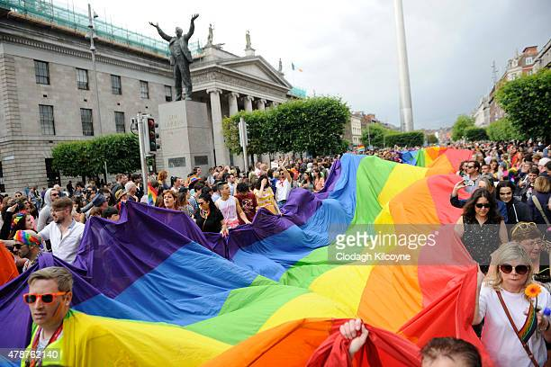 People take part in the annual Gay Pride Parade on June 27, 2015 in Dublin, Ireland. Gay marriage was declared legal across the US in a historic...