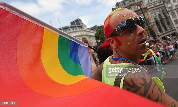 People take part in the annual Gay Pride street march through central London on July 4 2009 in London England This years parade theme is entitled...