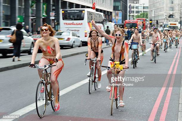 People take part in the annual 'London World Naked Bike Ride' event in central London on June 14 2014 in London England