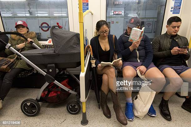 People take part in the annual 'No Trousers On The Tube Day' event in central London on January 8, 2017. Started in 2002 with only seven...