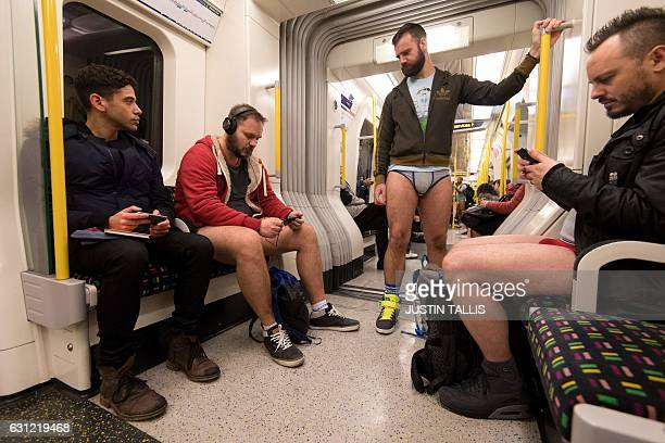 People take part in the annual 'No Trousers On The Tube Day' on a London Underground tube train event in central London on January 8, 2017. Started...