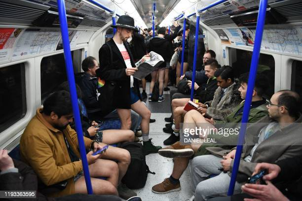 People take part in the annual 'No Trousers On The Tube Day' on the London Underground in central London on January 12, 2020. - Starting in 2002 with...