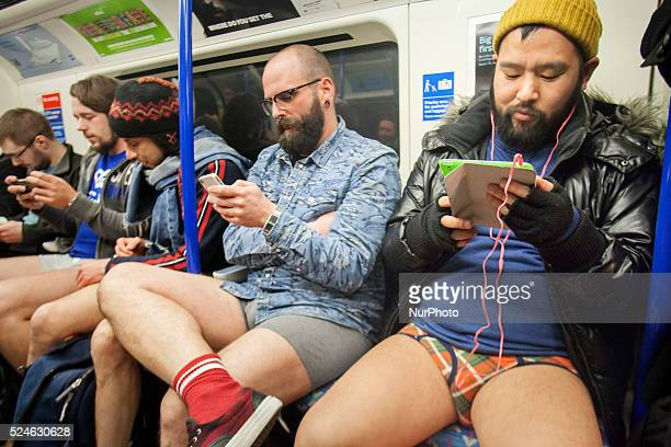People take part in the annual 'No Trousers Tube Ride' event on the London Underground No Pants Subway Ride London Britain 10 Jan 2016 Participants...