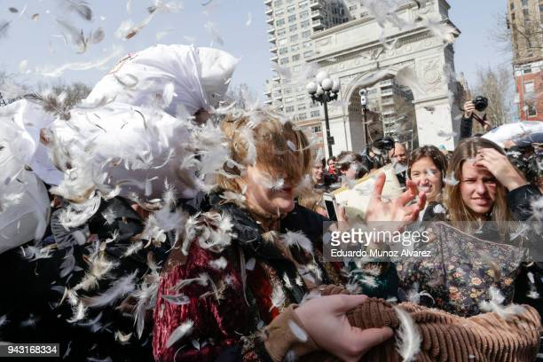 People take part in the Annual Pillow Fight at Washington Square on April 7 2018 in New York City The event takes place in over 100 cities around the...