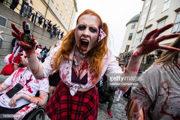 People take part in the annual Stockholm Zombie Walk at Riddarholmen on September 8 2018 in Stockholm Sweden