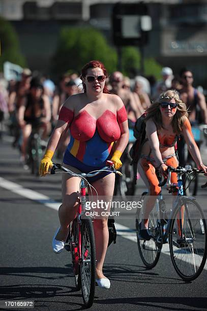 People take part in the annual World Naked Bike Ride in central London on June 8 2013 to protest against car culture and to raise awareness of...