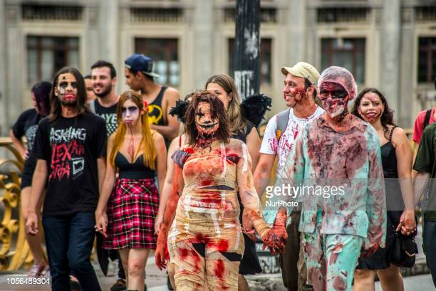 People take part in the annual Zombie Walk on November 2 in São Paulo People dress and use makeup to make themselves look like zombies and other...