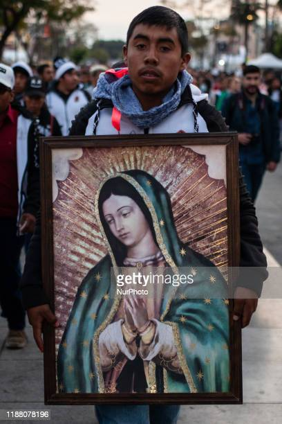 People take part in the celebration of the day of the Virgin of Guadalupe on December 11 2019 in Mexico City Mexico