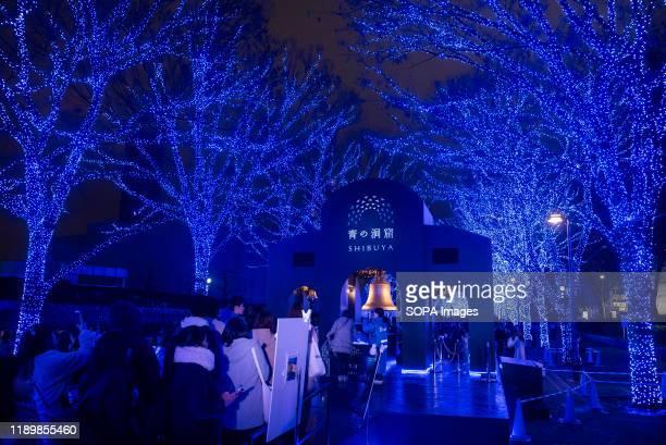 People take part in the Christmas theme 'Blue Cave' illumination event in at Yoyogi Park Shibuya The illumination event with 600000 light bulbs will...