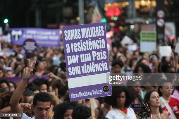 People take part in the commemoration of the International Women's Day at Paulista Avenue in Sao Paulo Brazil on March 8 2019 Protests strikes and...