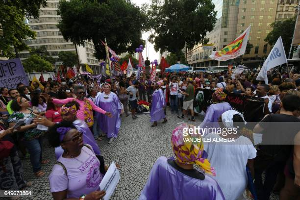 People take part in the commemoration of the International Women's Day at Candelaria square in Rio de Janeiro Brazil on March 8 2017 The...