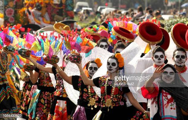 People take part in the Day of the Dead parade in Mexico City on October 27 2018