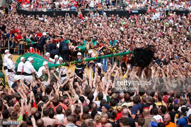 People take part in the Ducasse Doudou folkloric festival in Mons on June 11 2017 The Doudou festival was recognised in 2005 by the UNESCO as one of...