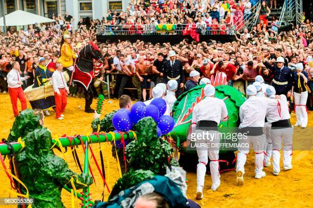 People take part in the Ducasse Doudou folkloric festival in Mons on May 27 2018 The Doudou feast a popular festival celebrated every two years on...