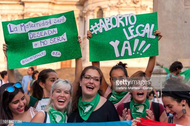People take part in the feminist demonstration 'Not one less' in support of the fight for legal abortion in Argentina in front of the Argentinean...