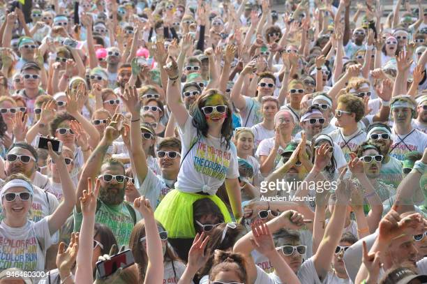 People take part in the fifth edition of The Colour Run starting at Hotel de Ville and finishing at the Eiffel Tower on April 15 2018 in Paris France...