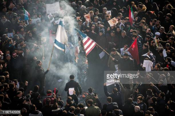 People take part in the funeral procession of IRGC Quds Force commander Lt. Gen. Qasem Soleimani, and Iraq's PMU second-in-command Abu Mahdi...
