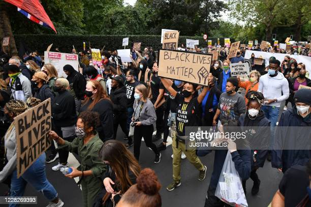 People take part in the inaugural Million People March march from Notting Hill to Hyde Park in London on August 30 to put pressure on the UK...