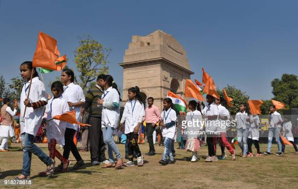 People take part in the Jal Mitti Rath Yatra which will bring water and Soil from four holy places in India for the Rashtriya Raksha Mahayagna which...