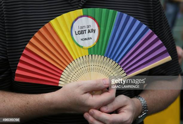 People take part in the Lesbian Gay Bisexual and Transgender parade in Hong Kong on November 6 2015 Hong Kong's streets were coloured by rainbow...
