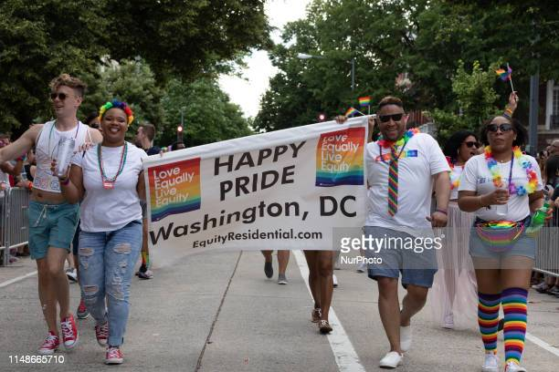 People take part in the LGBT Pride Parade in Washington DC June 8 2019